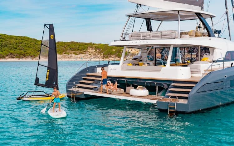 family enjoying water sports of the stern of a Lagoon Seventy7