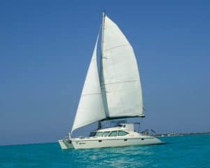 catamaran guru helped the owners of the kanina sailing school business find and purchase their catamaran and put it into business
