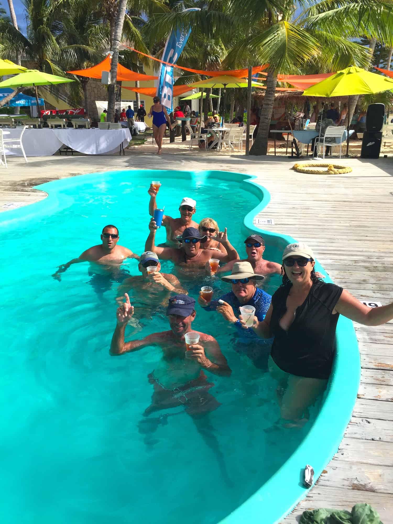 the regatta sailors enjoying drinks and a swim at grabbers on guana island